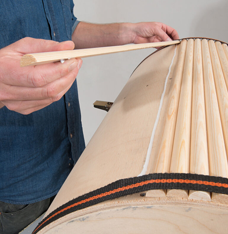 Gluing the half-round wooden strips