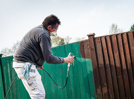 Paint a wooden fence