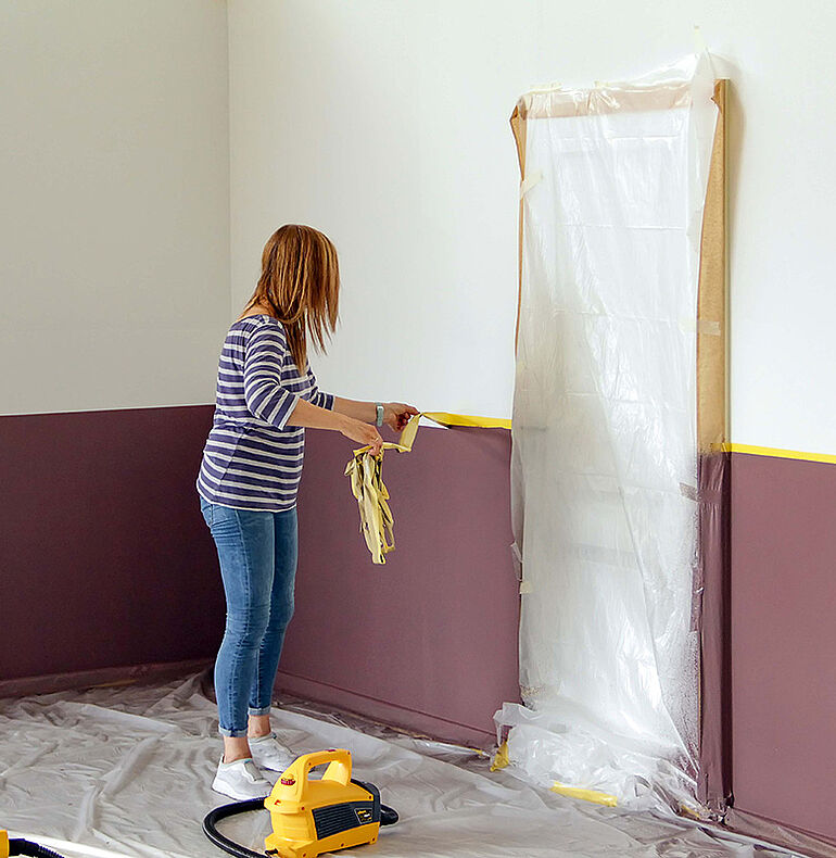 Applying paint to the wall